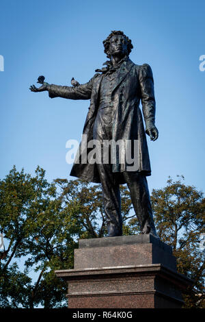 The poet Alexander Pushkin statue on the Square of Arts in front of the MikhayLovsky Palace, in St Persburg, Russia. - Stock Photo