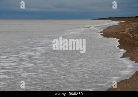Empty beach scene, calm sea in winter on North Sea Coast, Lincolnshire, England. - Stock Photo