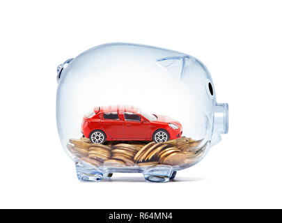 Red car on money inside transparent piggy bank with clipping path - Stock Photo