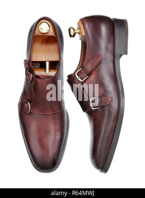 Pair of new elegant handmade mens shoes of brown leather with double monk strap buckle, viewed from above and the side, isolated on white background - Stock Photo