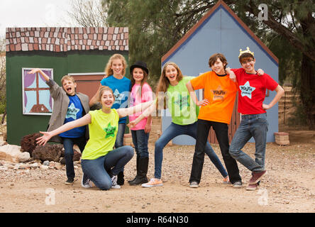 Friends at acting camp pose together - Stock Photo