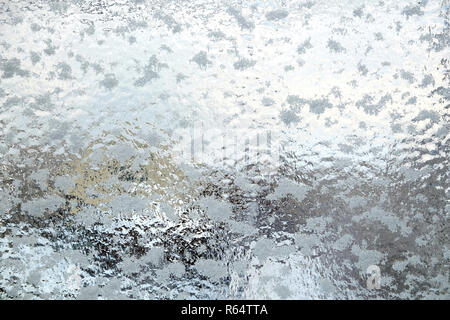 Beautiful hoarfrost tracery on frozen window a frosty day indoor vertical view closeup - Stock Photo
