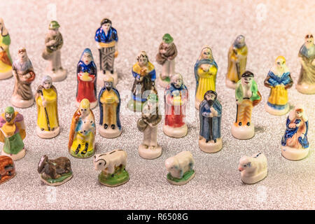 Small figurines of santons from French Provence used like beans of the cake of the kings during the Epiphany also called the Little Christmas on a gli - Stock Photo