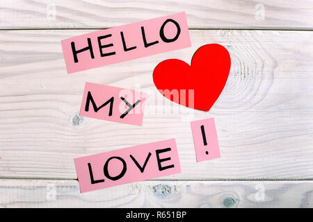 Message hello my love with heart shape on wooden table. - Stock Photo