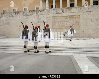 Athens, Greece - September 26, 2016: Change of Guard Ceremony in front of the Parliament Building on Syntagma Square by Evzones or Evzonoi soldiers - Stock Photo