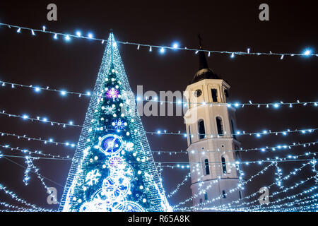Christmas tree installed at Cathedral Square in Vilnius, Lithuania. Illuminated at night - Stock Photo