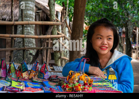 Hmong and Khmu children selling souvenirs near Luang Prabang Laos - Stock Photo