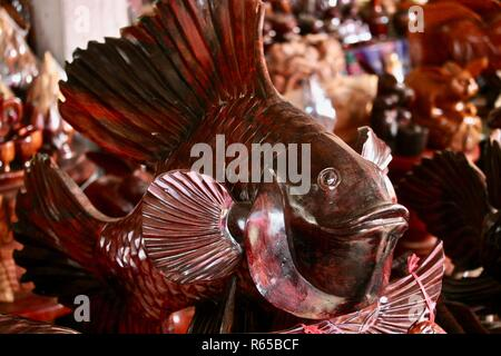 Wooden Siamese fighting fish carved by a master carver  in Cambodia - Stock Photo