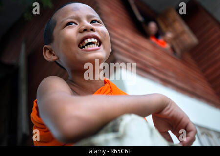 Young Monk in Wat Luang Pakse is a ancient Buddhist temple in Pakse in south Laos - Stock Photo