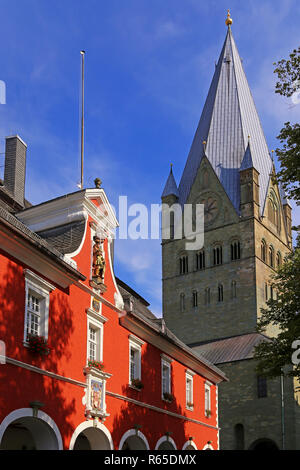 town hall and tower of the st. patrokli dome in soest - Stock Photo