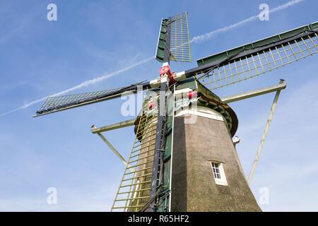 Traditional Dutch windmill. - Stock Photo
