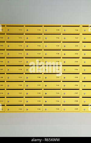 Yellow Mail boxes in the entrance of a building - Stock Photo