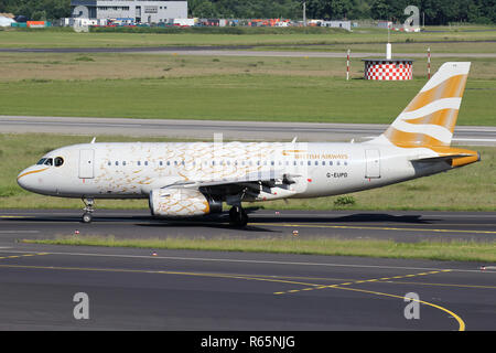 British Airways Airbus A319-100 in special Golden Dove livery with registration G-EUPD  on taxiway of Dusseldorf Airport. - Stock Photo