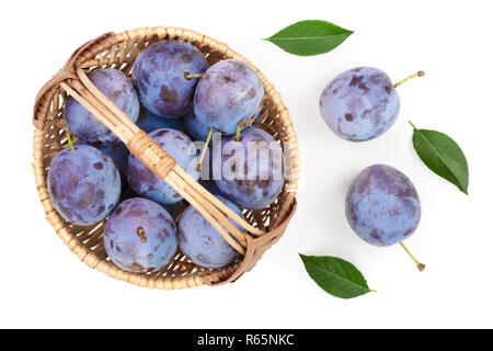 plums in wicker basket isolated on a white background. Top view. Flat lay pattern - Stock Photo
