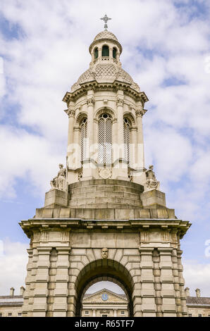Ornate bell tower under blue sky and puffy white clouds - The Trinity College Campanile in Dublin, Ireland - Stock Photo