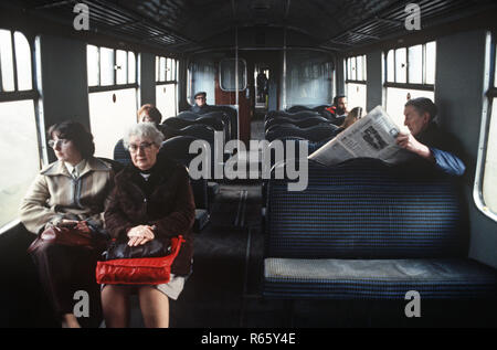 Railway passengers on the British Rail Preston to Colne railway line, Lancashire, Great Britain - Stock Photo