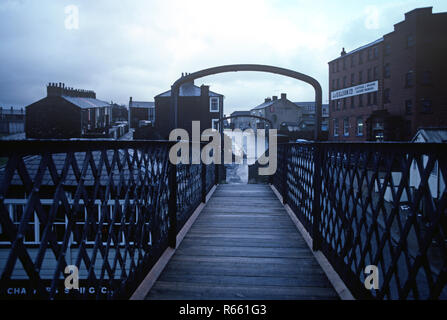 Railway metal footbridge over the British Rail Preston to Colne railway line at Chaffers Siding, Lancashire, Great Britain - Stock Photo