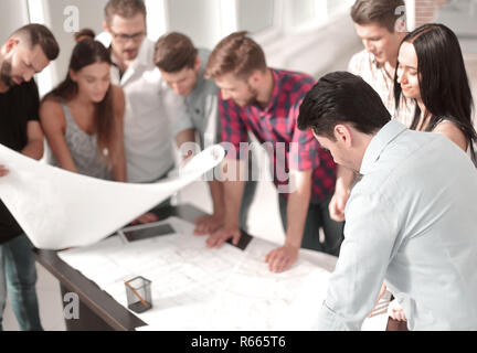 group of designers are looking at a new creative project - Stock Photo