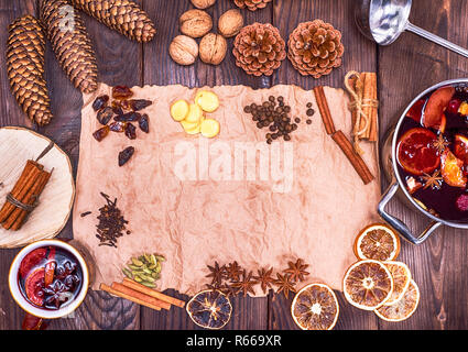 brown paper and ingredients for making mulled wine - Stock Photo
