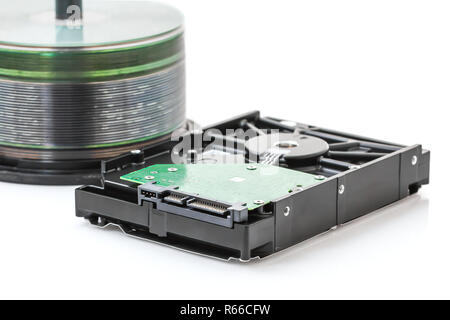 Hard disk drive and dvd discs - Stock Photo