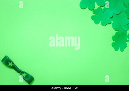 Shamrocks and a green bow tie - Stock Photo