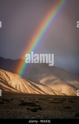 Colorful rainbow over mountains - Stock Photo