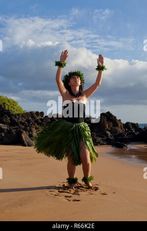Hula dancer on the beach on Maui, Hawaii. - Stock Photo