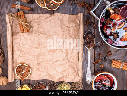 paper bundle of brown paper and ingredients for making mulled wine - Stock Photo
