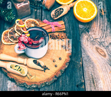 Mulled wine in an iron blue mug - Stock Photo