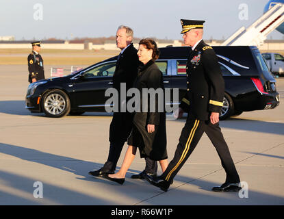 Former President, George W. Bush, with wife Laura Bush, depart from the airfield, Joint Base Andrews, Maryland, Dec. 03, 2018. Military and civilian personnel assigned to Joint Task Force- National Captial Region provided ceremonial and civil affairs support during President George H.W. Bush's state funeral. (DoD Photo by U.S. Army Pfc. Caeli Morris)