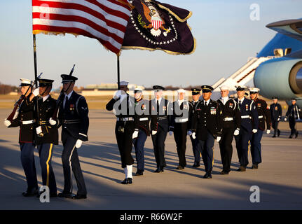 U.S. service members march along the flightline on Joint Base Andrews, Maryland, Dec. 03, 2018. Military and civilian personnel assigned to Joint Task Force-National Capital Region provided ceremonial and civil affairs support during President George H.W. Bush's state funeral.  (DoD photo by U.S. Army Pfc. Elijah Foster)