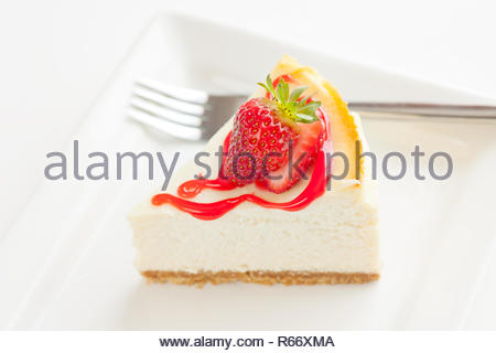 Cheesecake with fresh starwberries and sauce. - Stock Photo