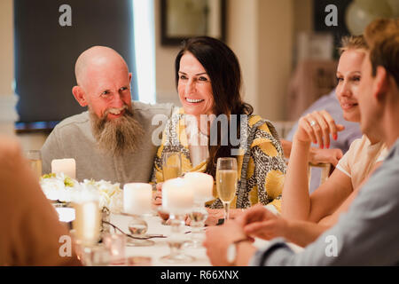 Wedding Guests Socialising At Dinner - Stock Photo