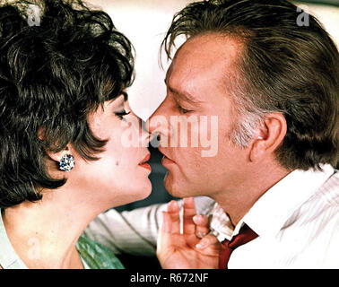 Elizabeth Taylor and Richard Burton in the film ''The Comedians'', directed by Peter Glenville in 1967.  (Photo by API/GAMMA/Gamma-Rapho via Getty Images) *** Local Caption *** Elizabeth Taylor;Richard Burton Credit: Hollywood Photo Archive / MediaPunch - Stock Photo
