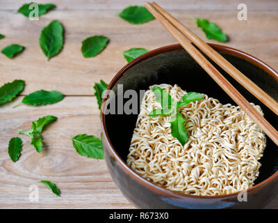 Instant noodles in black bowl. - Stock Photo