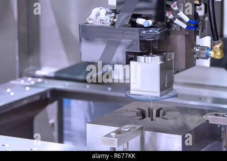 Wire cutting machine cutting metal - Stock Photo