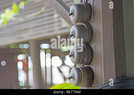 Switch on the ancient black light attached to the black wooden pole. - Stock Photo