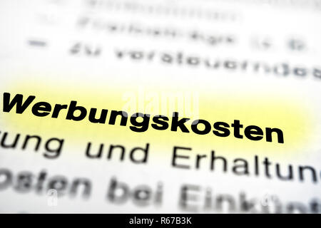 Text on page advertising costs highlight horizontal closeup - Stock Photo