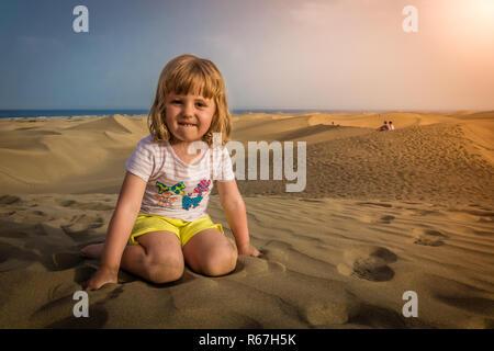 Girl on the sand dunes - Stock Photo