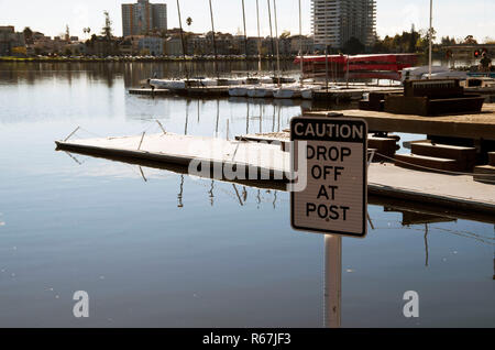 Signs are available to warn boaters at Lake Merritt, Oakland. - Stock Photo