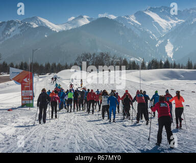 ALMATY, KAZAKHSTAN - FEBRUARY 18, 2017: amateur competitions in the discipline of cross-country skiing, under the name of ARBA Ski Fest. A large numbe - Stock Photo