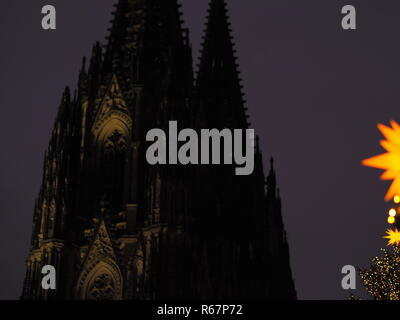 Christmas market stalls and shopping in Cologne, Germany - Stock Photo