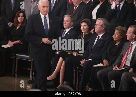 Vice President Mike Pence walks past former U.S. President George W. Bush, his wife former first lady Laura Bush and brother former Florida Governor Jeb Bush as Pence takes the podium to speak about the president's father former President George H.W. Bush during ceremonies in the U.S. Capitol Rotunda in Washington, U.S., December 3, 2018. Pool Via CNP/MediaPunch - Stock Photo