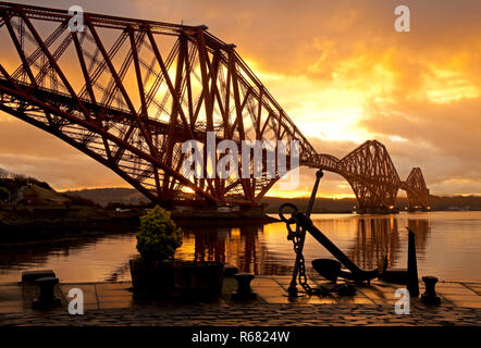 Forth Rail Bridge, North Queensferry, Fife, Scotland, UK. 4th Dec, 2018. Weather, looking towards South Queensferry a dramatic colourful sunrise - Stock Photo