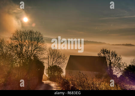 Wirksworth, UK. 03rd Dec, 2018. UK Weather: spectacular sunrise with cloud inversion at the star disc above Wirksworth in the Derbyshire Dales, Peak District National Park Credit: Doug Blane/Alamy Live News - Stock Photo