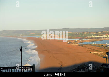 Portland, Dorset, UK. 4th December 2018. Chesil Beach is bathed in early-morning sunshine Credit: stuart fretwell/Alamy Live News - Stock Photo