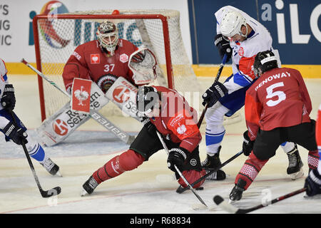 Brno, Czech Republic. 04th Dec, 2018. From left goalie JOHAN GUSTAFSSON, JACOB MOVERARE (both of Frolunda), RADIM ZOHORNA (Brno) and CHAY GENOWAY of Frolunda Indians in action during the Ice hockey Champions' League playoff quarterfinal opening game: Kometa Brno vs Frolunda Indians in Brno, Czech Republic, December 4, 2018. Credit: Vaclav Salek/CTK Photo/Alamy Live News - Stock Photo