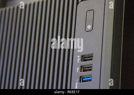 USB version 3.0 and button off in black model on computer - Stock Photo