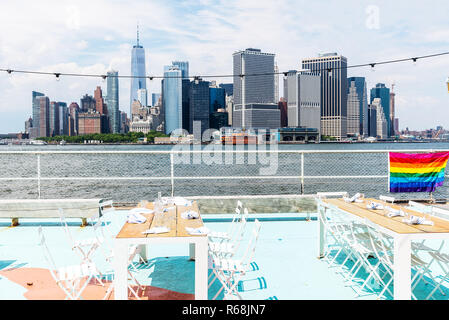Scenic view of the skyline of Downtown of Manhattan from promenade of Governors Island on summer - Stock Photo