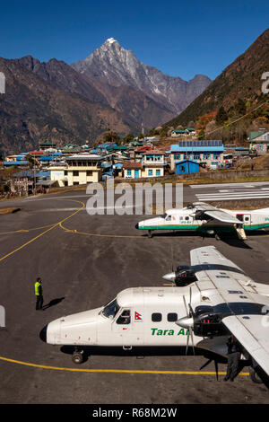 Nepal, Lukla, airport, two Tara Air Dornier 228-212 aircraft on apron of world's most dangerous airport - Stock Photo